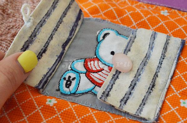 Развивающий коврик с пуговицей